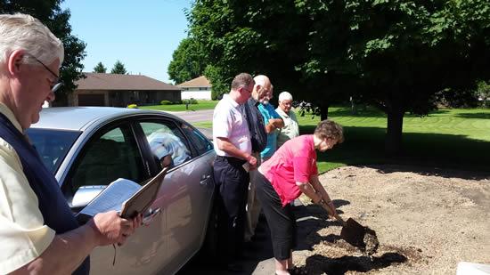 Kathleen turning the soil